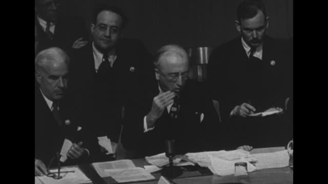 vídeos de stock e filmes b-roll de un security council delegates sit at semicircular meeting table / ms us secretary of state james byrnes leans back in his chair and looks perturbed /... - edward stettinius
