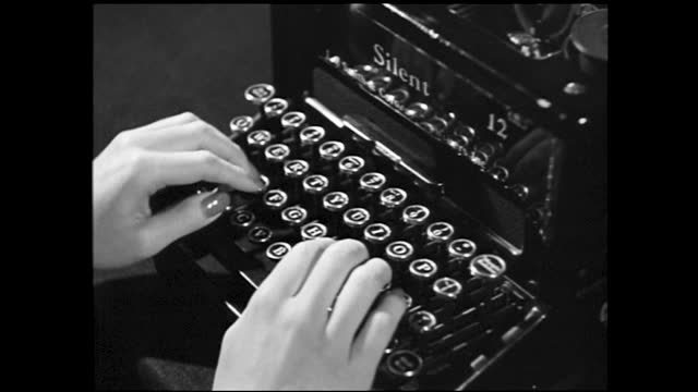 tilt down view of a key punch calculator; hand punching on calculator; two hands typing on typewriter - 1940 1949 stock videos & royalty-free footage