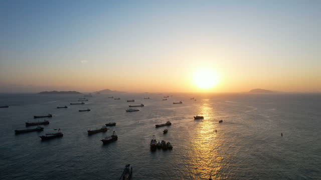 tilt down view of ships anchored in sea - anchored stock videos & royalty-free footage