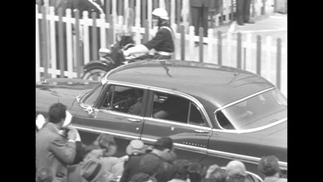tilt down vs grace kelly and prince rainier iii leave the yacht deo juvante via the gangplank / she accepts a bouquet of flowers from small costumed... - royal palace monaco stock videos and b-roll footage