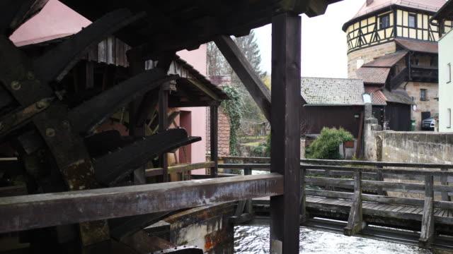 tilt down, watermill in lauf an der pegnitz - watermill stock videos & royalty-free footage