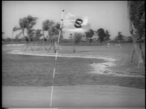 b/w 1962 tilt down wind blowing flag pond at ninth hole at doralryder open / miami / newsreel - doral stock videos and b-roll footage