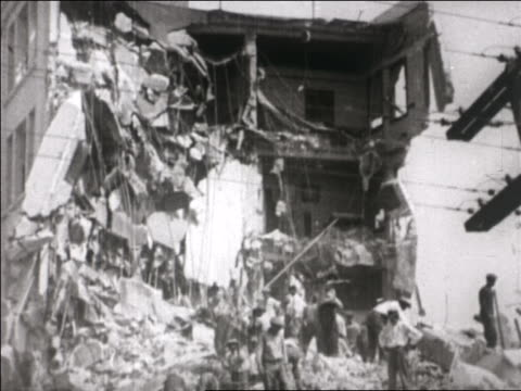 tilt down workers clearing debris from destroyed buildings after earthquake / santa barbara, ca - 1925 stock videos & royalty-free footage