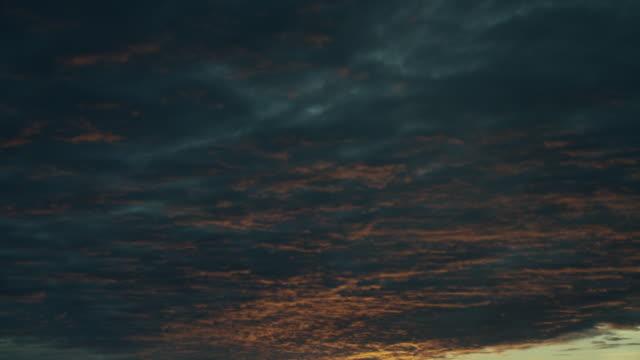 tilt from dark clouds to golden sunset - tilt down stock videos & royalty-free footage