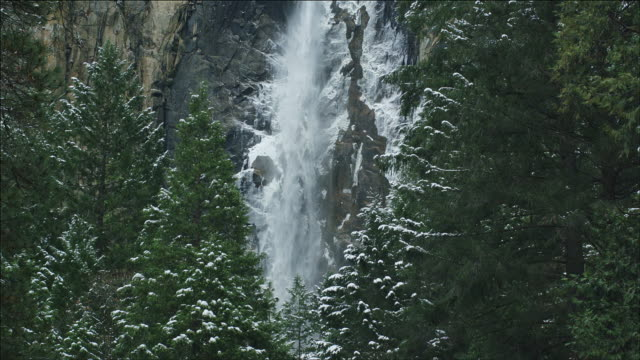 Tilt from trees, up Bridal Veil Fall, Yosemite National Park, slomo