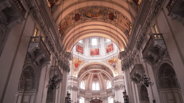 tilt interior view of salzburg cathedral , baroque cathedral of the roman catholic archdiocese of salzburg in the city of salzburg , salzburg, austria - traditionally austrian stock videos & royalty-free footage