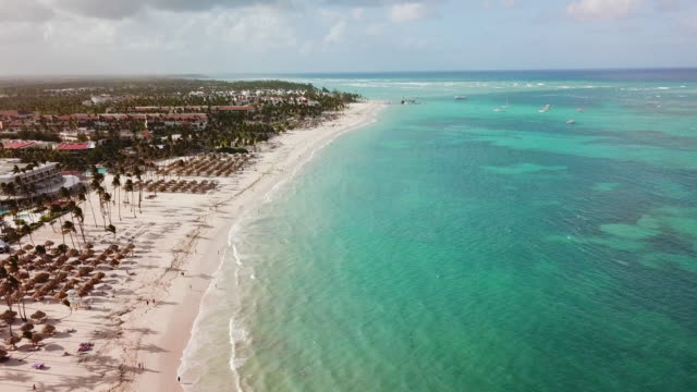 tilt: overlooking white sand beach in punta cana - punta cana stock videos and b-roll footage
