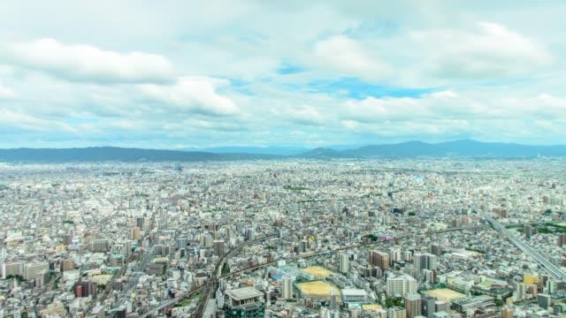 4k チルトパンニング大阪の阿倍野ハルカスから大阪市の空中写真を撮影。 - 町点の映像素材/bロール