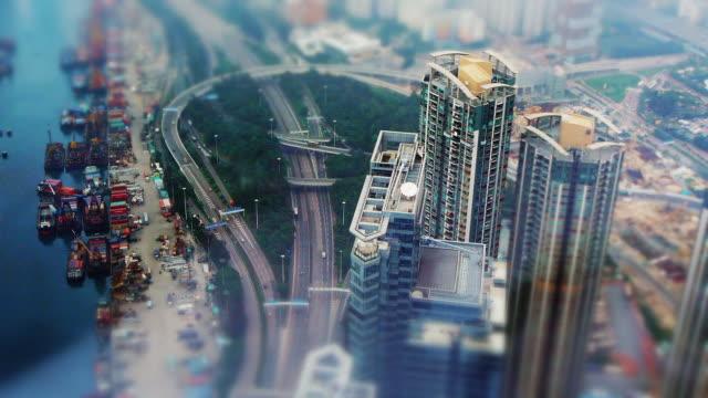vídeos y material grabado en eventos de stock de tilt shift high rise, highway and commercial harbor in hong kong - tilt shift