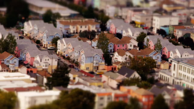 tilt shift miniature effect of cute pastel colored houses in the mission district in san francisco - small stock videos and b-roll footage