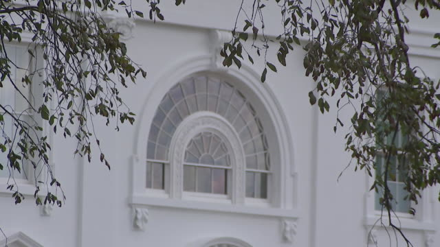 tilt shot of a window on the white house in washington, d.c. - history stock videos & royalty-free footage