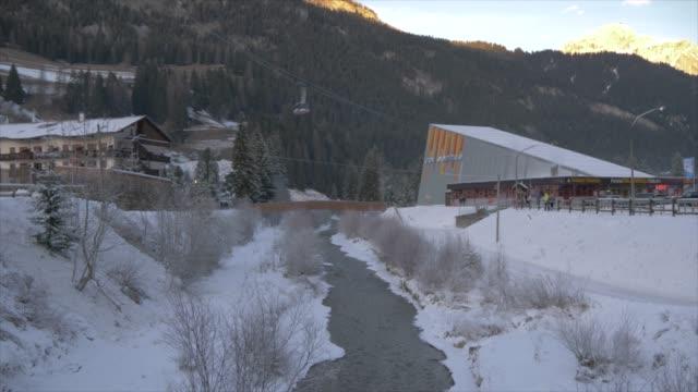 Tilt shot of Avisio River and cable car to Col Rodella, Campitello di Fassa, Province of Trento, Trentino-Alto Adige/Sudtirol, Italy, Europe