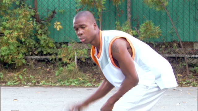 tilt shot of man dribbling basketball - see other clips from this shoot 1281 stock videos and b-roll footage