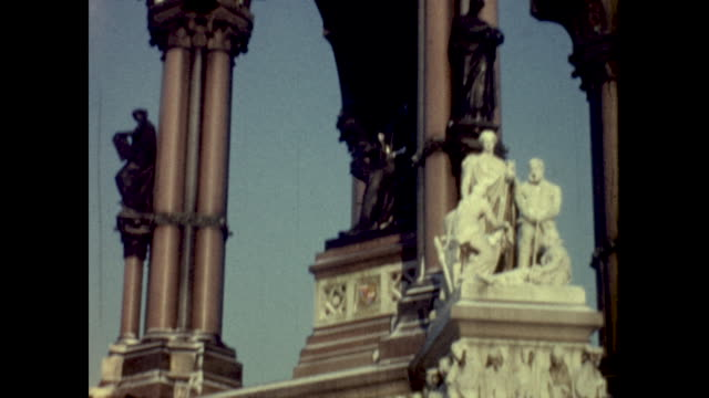 tilt shot of royal albert hall; tracking shot of airplane flying overhead; close up of the arched building, statues of people - colour image stock videos & royalty-free footage