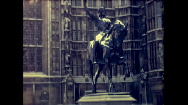 tilt shot of statue of richard coeur de lion in front of the palace of westminster, westminster abbey and statue of george v. - arts culture and entertainment stock videos & royalty-free footage