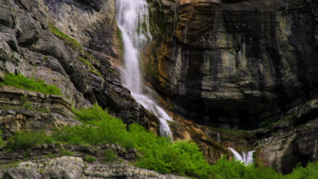 tilt shot of the full height of bridal veil falls in provo, utah. - provo stock videos & royalty-free footage