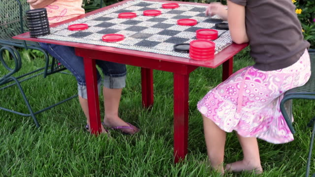 tilt shot of two little girls playing checkers. - draughts stock videos & royalty-free footage