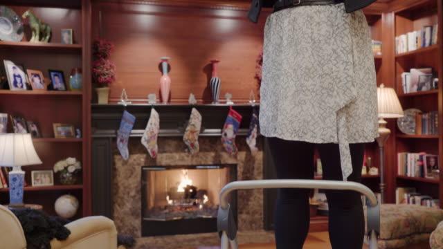 tilt shot of woman hanging mistletoe - solo una donna di età media video stock e b–roll