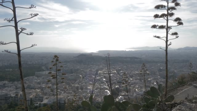 tilt shot over athens towards the acropolis from mount lycabettus, athens, greece, europe - lycabettus hill stock videos & royalty-free footage