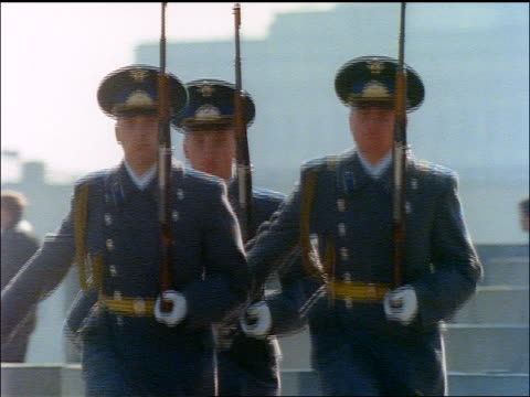 tilt up 3 russian soldiers marching towards camera / moscow - marciare video stock e b–roll