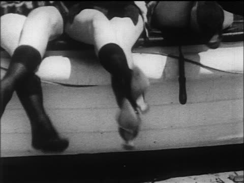b/w 1917/18 tilt up 3 women sitting in fur swimsuits + knee-high stockings - 1918 stock videos and b-roll footage