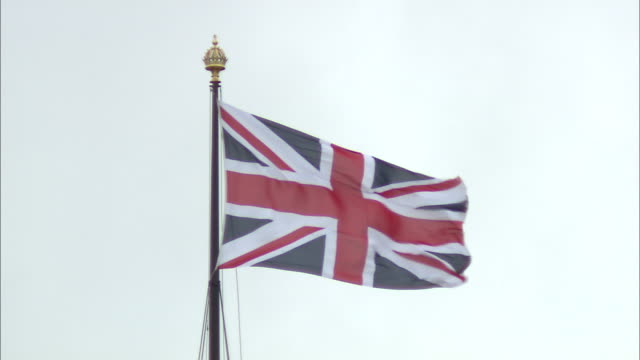 tilt up a tower of british parliament to the british flag waving in london, england. - music or celebrities or fashion or film industry or film premiere or youth culture or novelty item or vacations stock videos & royalty-free footage
