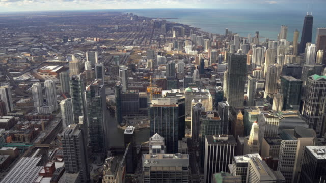 tilt up: aerial high angle view cityscape of chicago skyscraper skylines building il usa. usa modern landmark business and travel destination concept. - tilt stock videos & royalty-free footage