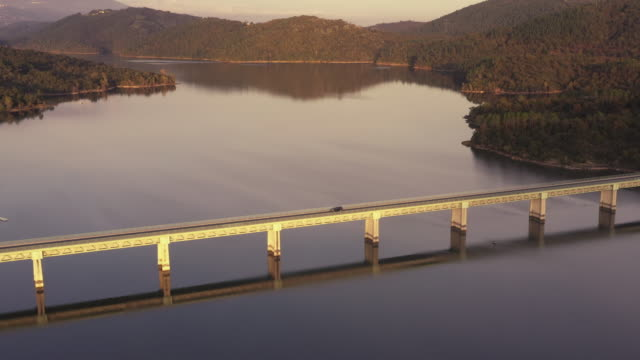 tilt up aerial shot showing a bridge crossing a reservoir, france - var stock videos & royalty-free footage