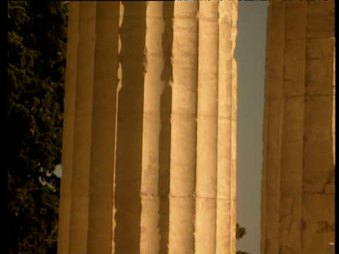 tilt up ancient greek column of parthenon from bottom to top in dimly lit in orange sunset athens - old ruin stock videos and b-roll footage