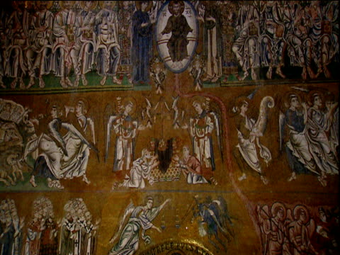 Tilt up ancient mosaic depicting scene of the last judgment on wall inside Torcello Basilica