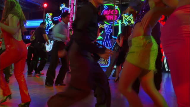 tilt up and down around nightclub as couples salsa dance, los angeles available in hd. - disco dancing stock videos & royalty-free footage