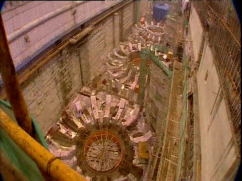 tilt up and right from turbines to building work on three gorges dam in yangtze river yichang hubei province - turbine stock videos & royalty-free footage