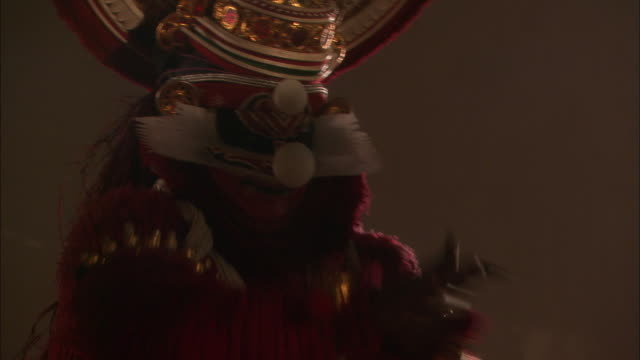 Tilt up as Kathakali dancers perform Available in HD.