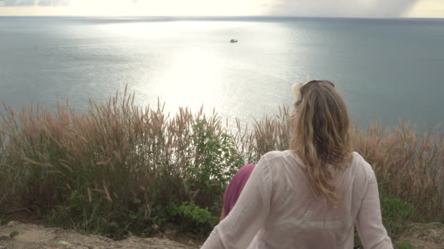 tilt up as woman looks out to sea - pct stock videos and b-roll footage