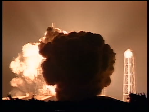 tilt up atlantis space shuttle taking off from launch pad at night / sts-79 - space mission stock videos & royalty-free footage