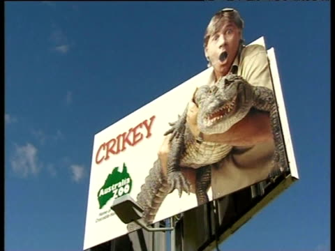 Tilt up billboard featuring Steve Irwin holding a crocodile outside Australia Zoo Australia 19 Sep 06