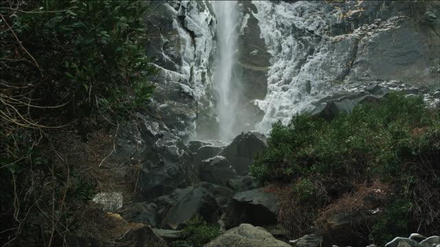 tilt up bridal veil falls, yosemite national park, winter, slomo - yosemite national park stock videos and b-roll footage