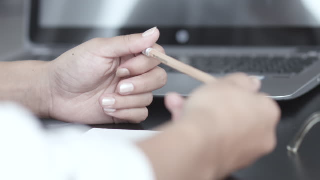tilt up, businessperson plays with pencil in meeting - pencil stock videos & royalty-free footage