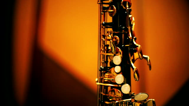 tilt up camera : saxophone standing on a stage. - alto saxophone stock videos and b-roll footage