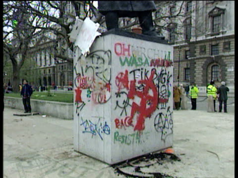tilt up churchill statue with balloons graffiti and turf mohican after may day riots; 01 may 00 - turf stock videos & royalty-free footage