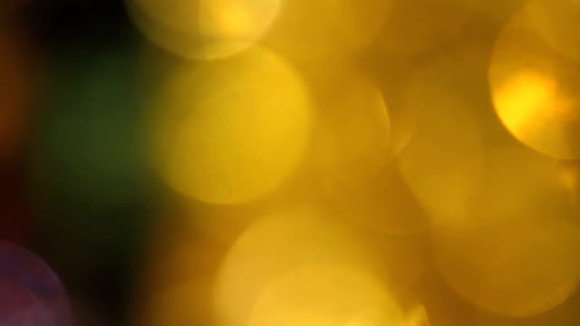 tilt up. colorful bokeh circles of christmas lights - full frame stock videos & royalty-free footage