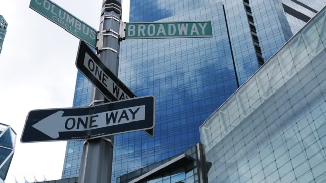 tilt up, columbus circle and broadway street sign - one way stock videos & royalty-free footage