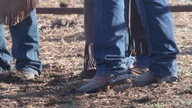 Kippen Sie nach oben Cowboy-Stiefel, Viehzüchter, die Diskussion über den Arbeitstag
