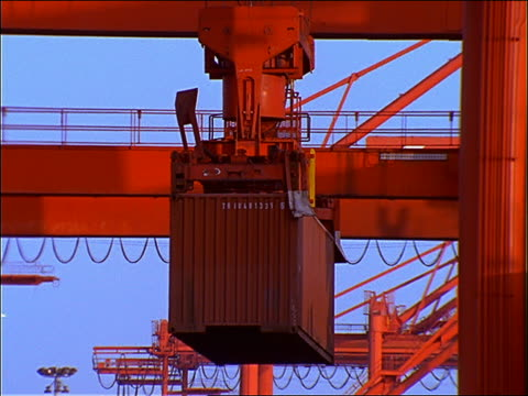 tilt up crane lifting container at shipping port / seattle - seattle stock videos & royalty-free footage