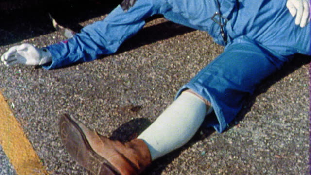 1968 ms tilt up crash test dummy lying on ground next to car after crash test - crash test stock videos & royalty-free footage