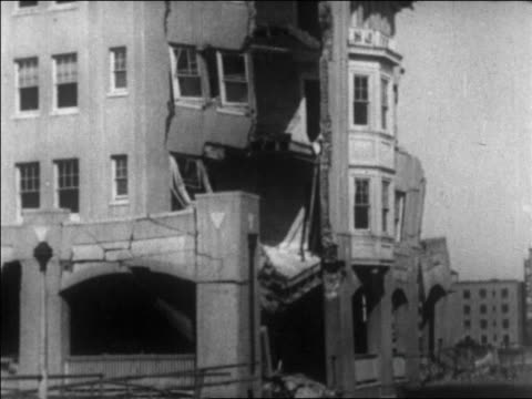 b/w 1926 tilt up damaged hotel / long beach california / newsreel - 1926 stock videos & royalty-free footage