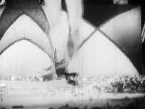 b/w 1928 tilt up dancer in skimpy outfit dancing madly in nightclub floor show / newsreel - 1928 stock videos & royalty-free footage