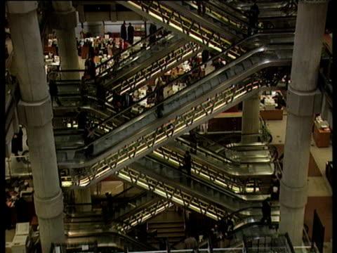 stockvideo's en b-roll-footage met tilt up escalators lloyds of london - 1996
