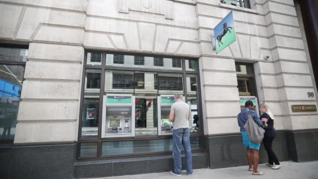 tilt up exterior of a lloyds tsb bank branch, part of the lloyds banking group plc, in london, u.k., on 12th august 2013, a logo sits on a sign... - branch plant part stock videos & royalty-free footage