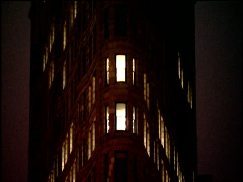 tilt up facade of flat iron building at night manhattan - flatiron building manhattan stock videos and b-roll footage